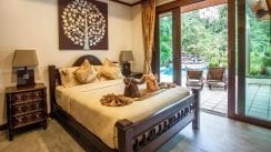 VS2 VS2-27.Queen-size-3rd-bedroom-opens-up-to-views-of-pool-waterfall-lake-and-mountain.jpg